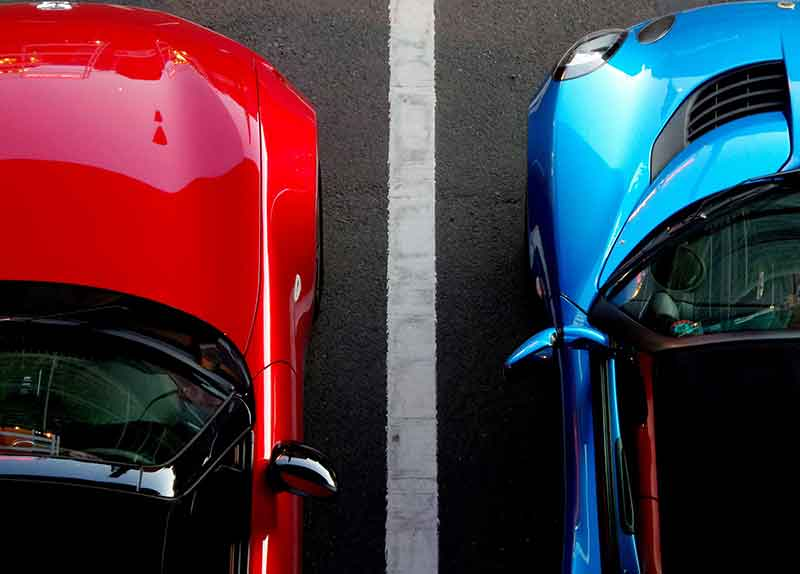 top down view of a red and blue car side-by-side